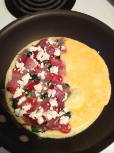 Omelette of 1 egg, 1/2 c. egg whites, 1 slice proscuitto, 1 oz. goat cheese, wilted spinach and fresh tomatoes